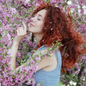 crystal aromatherapy recipes woman smelling flowers